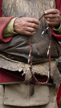 Old man with mani (prayer) beads