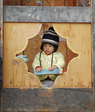 Child in Window in Bhutan