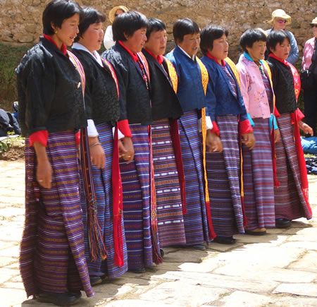 Women dancing at tsechu