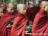 Monks at lunch in Mandalay, Burma