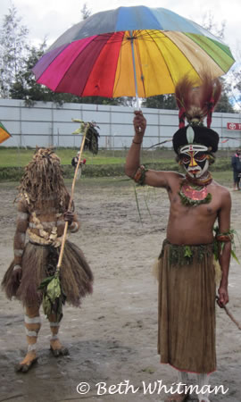 Enga tribe with umbrella in rain