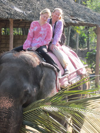 Jan and Amanda riding an elephant