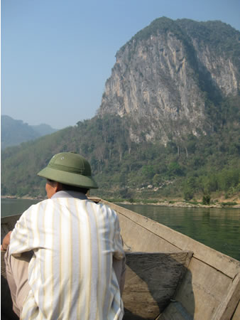 Man in boat near Mai Chau