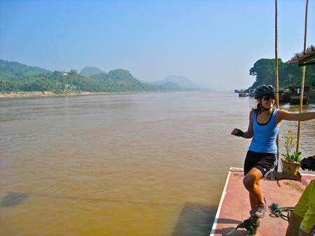 Woman Biker at Mekong Riverbank