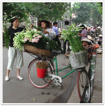Women selling flowers in Hanoi