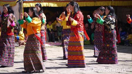 Women dancing at Bumthang tsechu