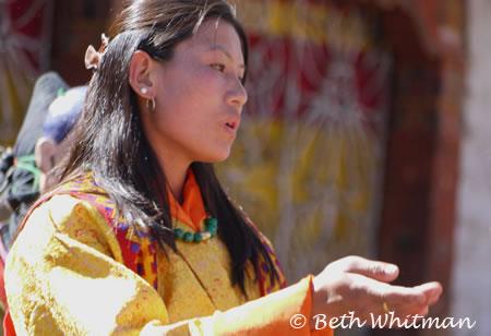 Woman dancing at Bumthang tsechu