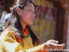 Woman dancing at Bumthang tsechu