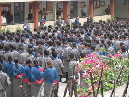 School group saying prayers