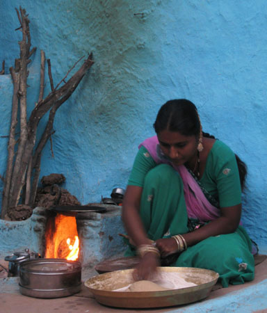 Bishnoi woman cooking in Rajasthan
