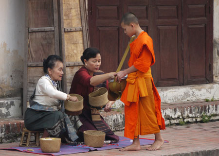 Monk accepting alms in Luang Prabang