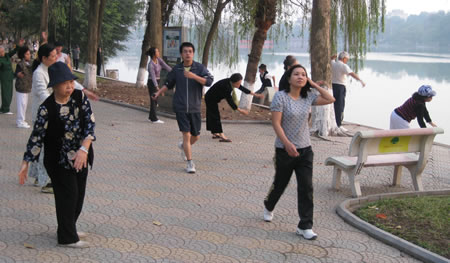Exercising at Hoan Kiem Lake