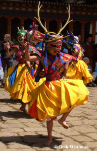 tsechu dancers in bhutan