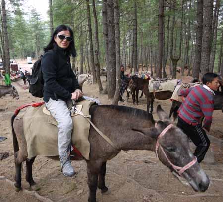 Riding a horse in Bhutan