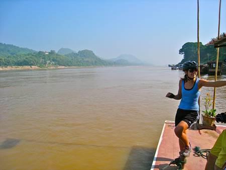 Woman Biker at Mekong Riverbank